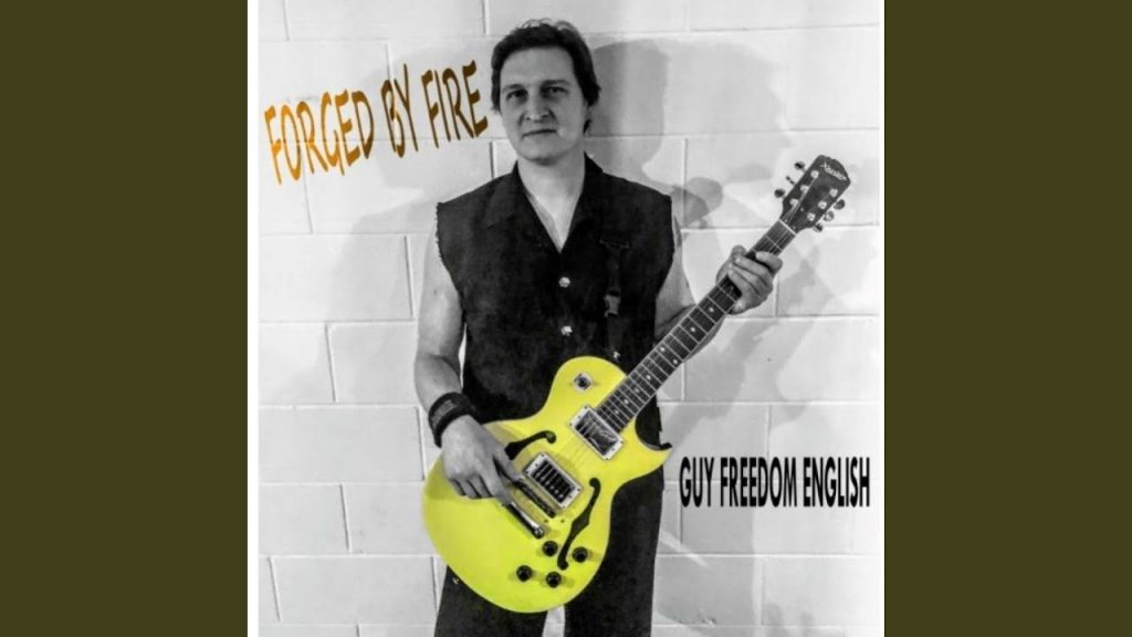 MusikHolics - Guy Freedom English - Forged by Fire